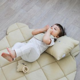 baby laying on a soft baby play mat
