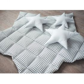 white soft baby play mat with black dots in star shape with white cushions