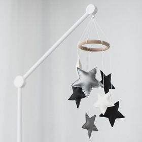 cot mobile toy with silver, white and black stars hanging made out of faux leather
