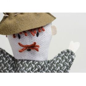little old man with mustache and hat hand puppet close up