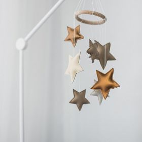 cot mobile toy with gold, cream and grey stars hanging made out of faux leather