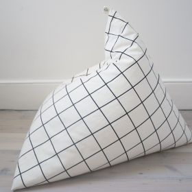 Grid pattern bean bag by wildfire teepees  on the floor