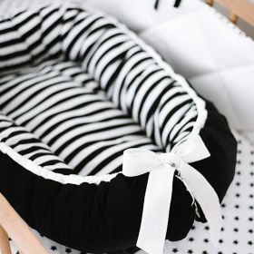 baby nest with stripes in the inside and black on the outside with white ribbon at the end