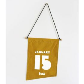 yellow birthday flag hanging from the wall with black ribbon