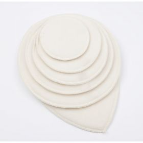 different size and shape nursing pads on top of each other