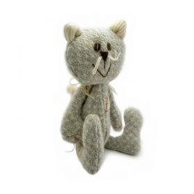 grey cat soft toy made out of wool with ears and paws