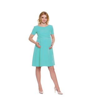 pregnant woman wearing an elegant mint green dress with high heels