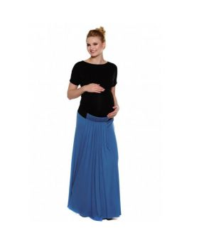 pregnant woman holding her belly, wearing a black maternity top and long blue maternity skirt